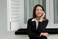 Businesswoman talking on a mobile phone and smiling