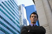 Low angle view of a businessman standing with his arms crossed