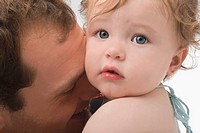 Close-up of a young man loving his daughter (thumbnail)