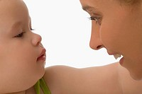 Close_up of a mid adult woman looking at her daughter and smiling