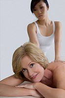 Close_up of a mature woman receiving a back massage from a massage therapist