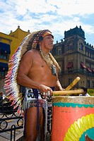 Mature man playing drums with drumstick, Zocalo, Mexico City, Mexico