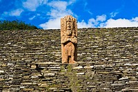 Low angle view of a statue on a stone wall, Tonina, Ocosingo, Chiapas, Mexico