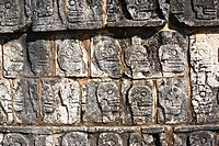 Close_up of skulls carved on the wall, Chichen Itza, Yucatan, Mexico