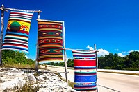 Three beach towels hanging on wooden poles, Tulum, Quintana Roo, Mexico