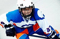 Portrait of a boy playing ice hockey