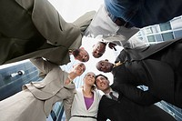 Low angle view of a group of business executives standing in huddle