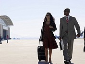 Two businesspeople walking at airport