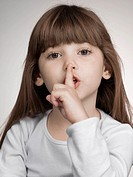 Girl holding finger to lips