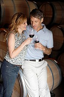 Couple drinking red wine in cellar