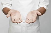 Flour on chef´s hand mid section