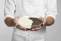 Chef holding bowl of white and wild rice mid section