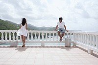 Young couple on balcony at resort, St. John, US Virgin Islands, USA