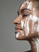 Moisturizer on young woman´s face