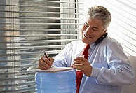 Businessman on Phone by Water Cooler
