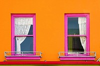Coloured wall and windows. Galway City. Co. Galway. Ireland