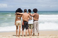 Multi_ethnic friends hugging at beach