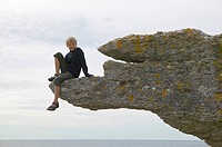 Boy on sea stack