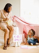 African grandmother offering granddaughter lemonade