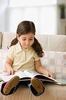Young girl reading story book