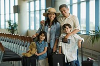 Hispanic family waiting in airport