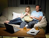 Young couple watching a movie (thumbnail)