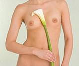 Nude female holding calla lily