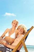 Young couple sharing a deck chair