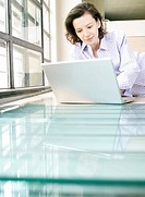 Woman on laptop in home office