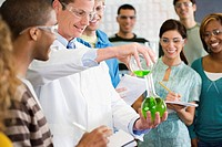 Student Doing Chemistry Experiment in Class