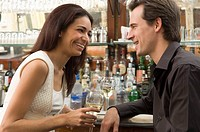 Couple talking at bar