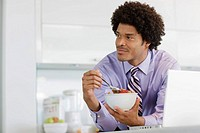 Businessman Eating Breakfast