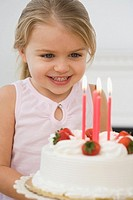 Girl smiling at birthday cake