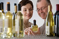 Couple looking at wine in store