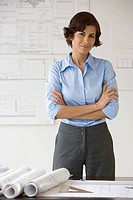Female architect with arms crossed