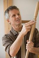 Man sanding piece of wood