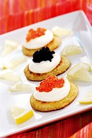 Blini with sour cream snd caviar