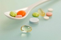 Pills on spoon, close_up