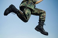Army soldier jumping