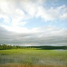 Finland, Hossa National Park, Lake under cloudy sky