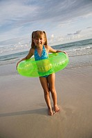 Girl in inner tube at beach, Florida, United States