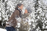 Austria, Salzburger Land, Altenmarkt, Young couple fooling around with snow