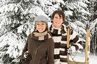 Austria, Salzburger Land, Altenmarkt, Young couple in snowscape, portrait