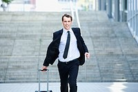 Germany, Baden_Württemberg, Stuttgart, Businessman running