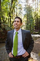 Mixed Race businessman in woods