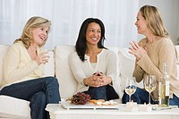 Multi_ethnic women laughing