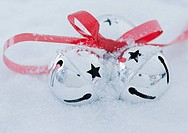 Close up of jingle bells in snow