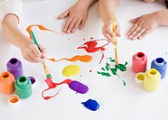 Children painting on table