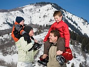 Family in front of snowy mountain