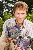 Man holding red cabbage, portrait